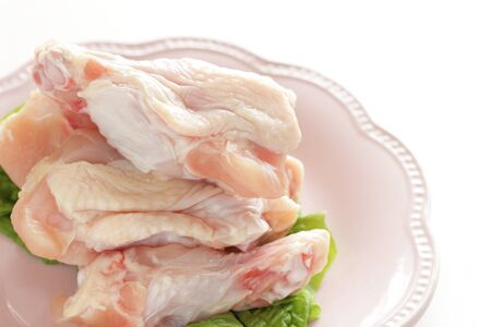 Freshness chicken drumsticks on dish with copy space 版權商用圖片