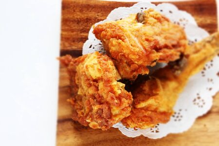 Fried chicken on wooden plate Stock Photo