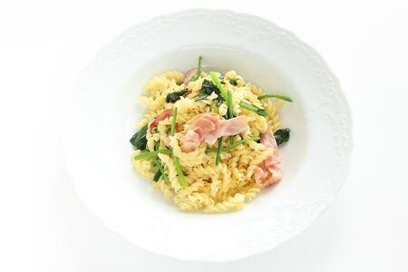 Italian food, bacon and spinach fusilli short pasta