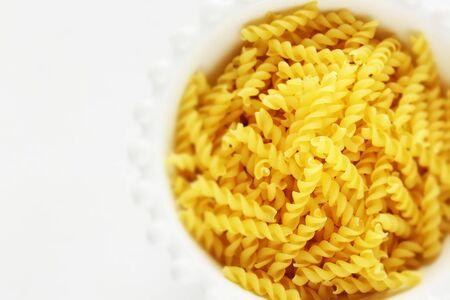 Dried pasta short, Fusilli in bowl
