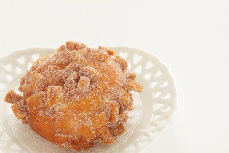Sugar deep fried bread on dish with copy space Reklamní fotografie