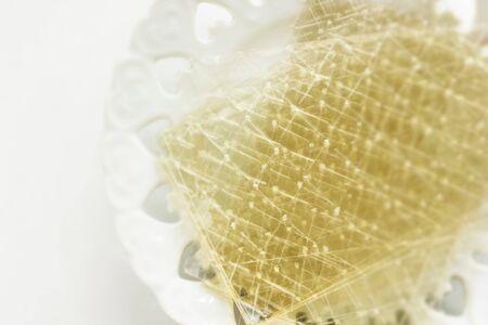 Gelatin sheet on dish for cooking ingredient image 版權商用圖片 - 134771696