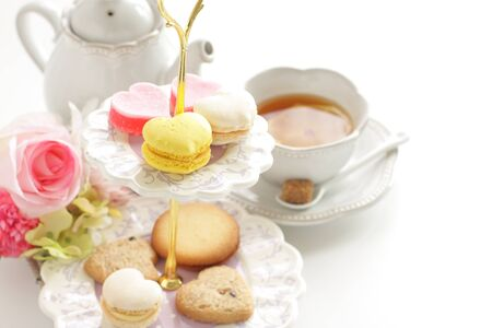 Heart shaped candy and cookie for afternoon tea image