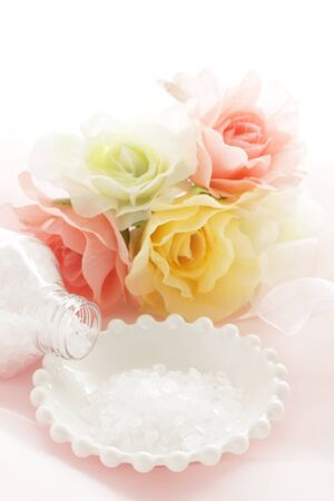 rock salt on white dish with flower for beauty image Stock Photo