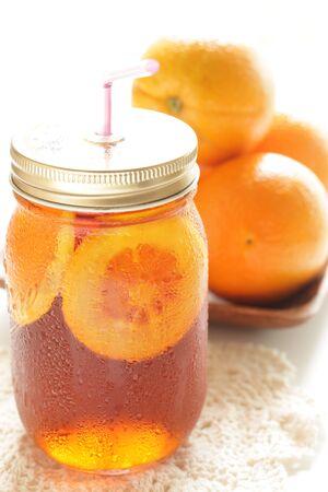 Freshness orange and jar drink tea Banco de Imagens - 134067857