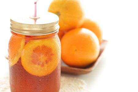 Freshness orange and jar drink tea Banco de Imagens - 134067860