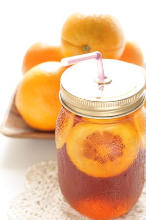 Freshness orange and jar drink tea Banco de Imagens - 134067862