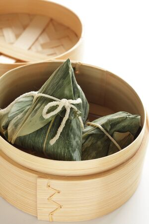 Chinese dumpling, meat and sticky rice wrapped zongzi in bamboo basket Reklamní fotografie