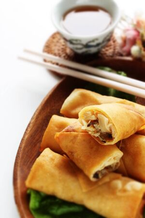 Chinese food, spring roll on wooden plate
