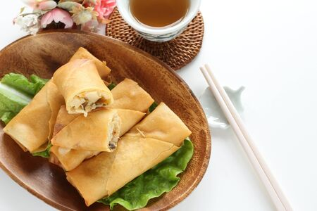 Chinese food, spring roll on wooden plate Stock Photo - 137413228