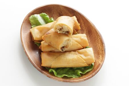 Chinese food, spring roll on wooden plate Stock Photo - 137413233