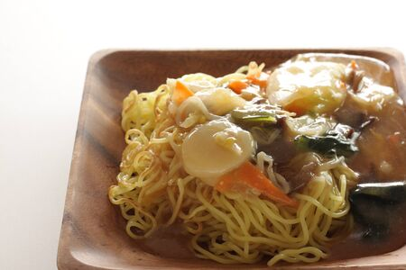 Chinese food, stir fried vegetarian and scallop on pan fried ramen noodles Stok Fotoğraf