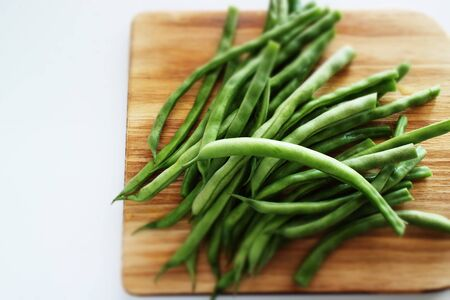 green bean on wooden board with copy space