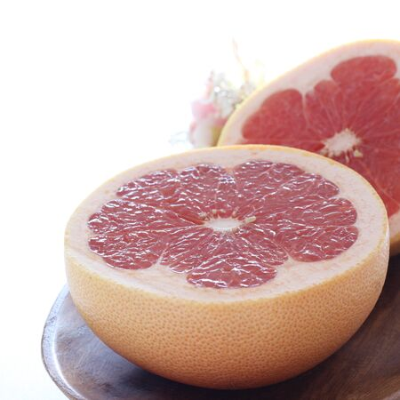 Freshness red ruby grapefruit in half on white
