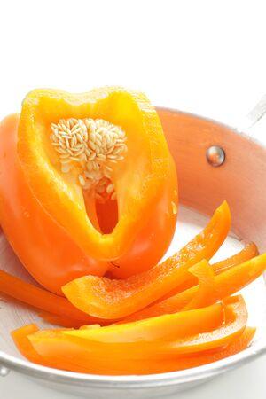 Orange color chopped orange paprika on pan for prepared food ingredient