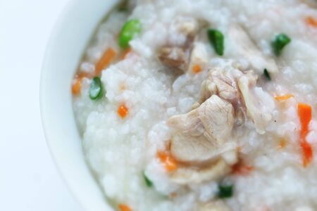 Chinese food, chicken and vegetable congee for healthy breakfast Stock Photo