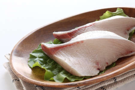 Freshness yellow tail filling on wooden plate 스톡 콘텐츠