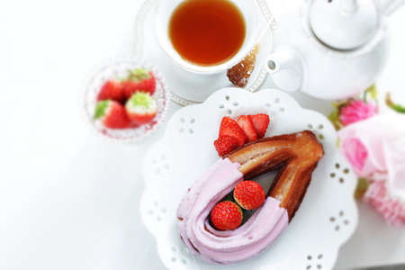 strawberry coating churros on dish for spring sweet food Imagens