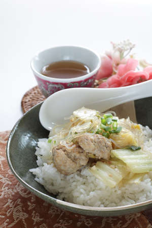 Chinese food, meat ball and cabbage simmered with glass noodles on rice
