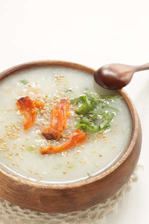 Asian food, grilled salmon in Chinese congee Stock Photo