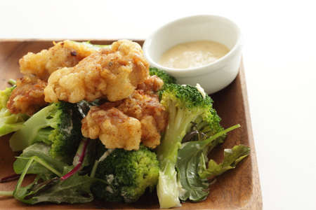 Homemade fried chicken served with boiled broccoli