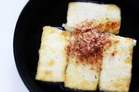 Japanese food, pan fried tofu and Katsuobushi in skillet pan