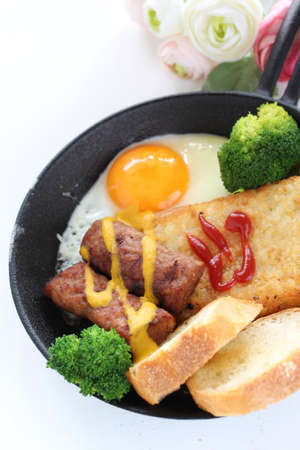 hashed brown and sausage with sunny side up fried egg for gourmet breakfast