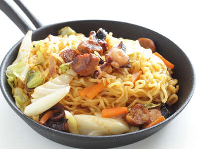 Chinese food, octopus and sausage with cabbage fried noodles