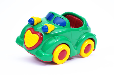 tilted: Green, blue and yellow toy car, tilted Stock Photo