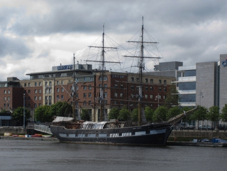 River Liffey and sailing ship with cloudy sky, Dublin, Ireland