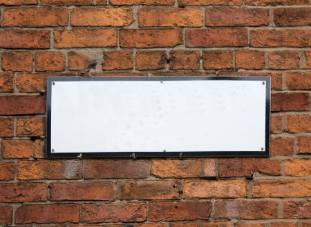 Empty Sign Board On A Brick Wall photo