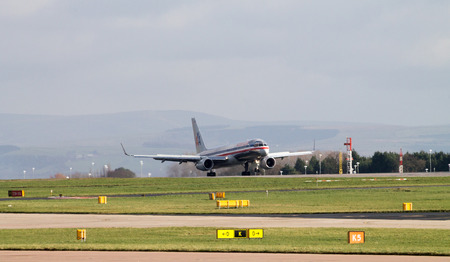 Manchester, United Kingdom - February 16, 2014  American Airlines Boeing 767 plane landing on Manchester Airport runway
