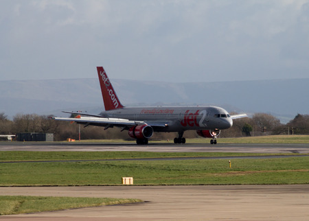 Manchester, United Kingdom - February 16, 2014  Jet2 Airways Boeing 757 taxiing on Manchester Airport runway