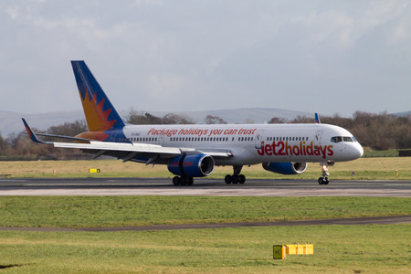 Manchester, United Kingdom - February 16, 2014  Jet2Holidays Boeing 757 in new livery, taxiing on Manchester Airport runway, full frame view, side profile