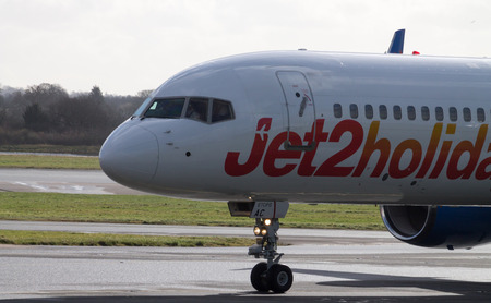 Manchester, United Kingdom - February 16, 2014  Jet2Holidays Boeing 757 in new livery, taxiing on Manchester Airport runway, front part
