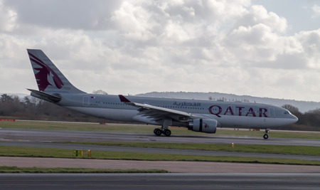 Manchester, United Kingdom - February 16, 2014  Qatar Airlines Airbus A330 arriving to Manchester Airport