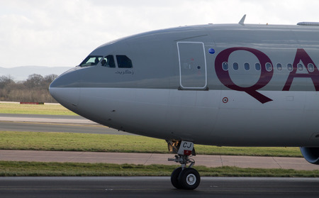 Manchester, United Kingdom - February 16, 2014  Qatar Airlines Airbus A330 arrives to Manchester Airport