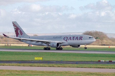 Manchester, United Kingdom - February 16, 2014  Qatar Airlines Airbus A330 taking off from Manchester Airport runway