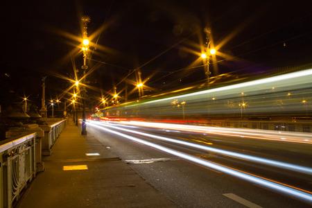 Tram crossing a bridge in Prague, Czech Republic photo