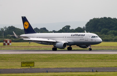 Manchester, United Kingdom - June 14, 2014  Lufthansa Airbus A320 taxiing on Manchester International Airport runway