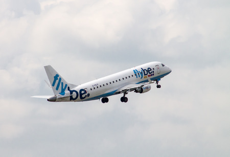 Manchester, United Kingdom - June 14, 2014  Flybe Embraer ERJ-195 taking off from Manchester International Airport