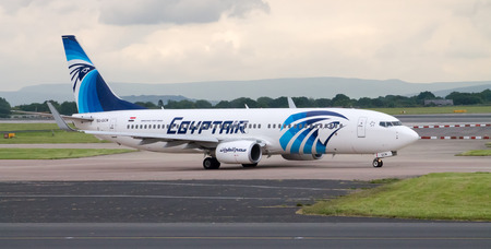 Manchester, United Kingdom - June 14, 2014: EgyptAir Boeing 737 taxiing, Manchester Airport