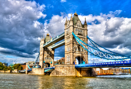 south london: Tower Bridge, famous combined bascule and suspension bridge which crosses River Thames, London, United Kingdom, HDR