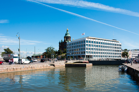 enso: Uspenski Cathedral and Stora Enso Headquarter in Helsinki, Finland, sunny weather with deep blue sky