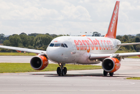 jetplane: easyJet Airbus A319 passenger plane taxiing on Manchester Airport taxiway.