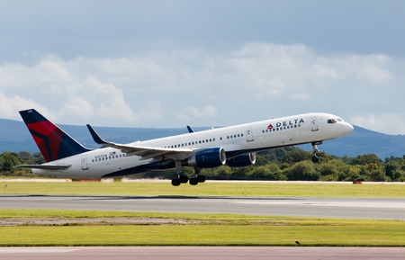 Delta Airlines Boeing 757 passenger plane taking off from Manchester Airport.