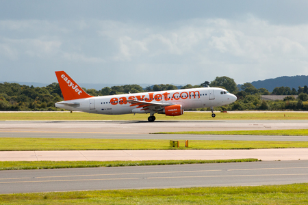 jetplane: easyJet Airbus A319 passenger plane taking off from Manchester Airport taxiway. Editorial