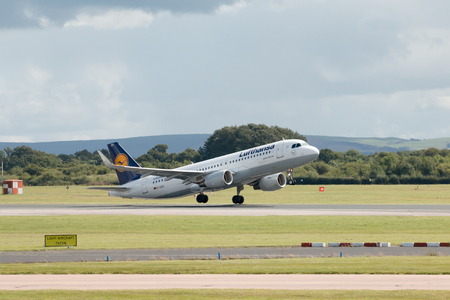 taking off: Lufthansa Airbus A320 -200 passenger plane taking off from Manchester International Airport. Editorial
