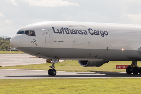 Lufthansa Cargo MD-11 freight plane taxiing after landing to Manchester International Airport runway. Editorial