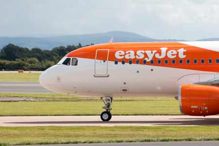 jetplane: easyJet Airbus A319 passenger plane in new livery G-EZON taxiing on Manchester Airport taxiway. Editorial